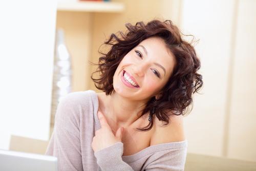 woman in lounge wear smiling