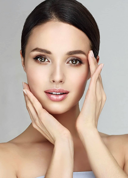 stock image of a female model holding hands on face