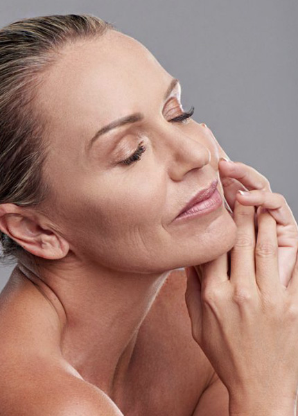 stock image of a female model holding hand on face