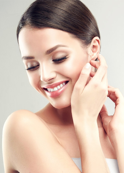 stock image of a female model with smiling face